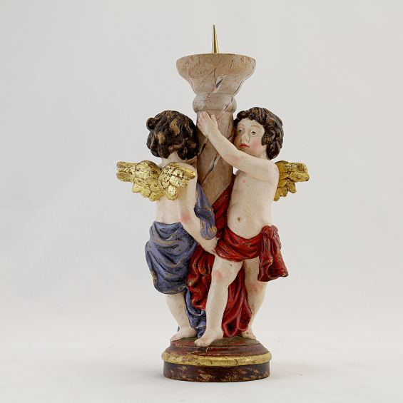 Candle holder with cherubs